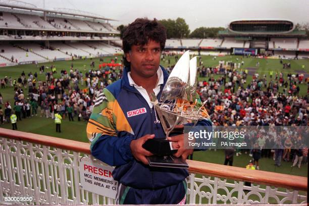 Sri Lankan captain Arjuna Ranatunga hold the Emirates Triangular Tournament trophy after defeating England in the final oneday international at Lords...