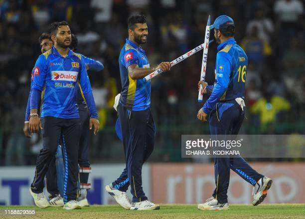 Sri Lankan captain Dimuth Karunaratne and teammate Lahiru Kumara celebrate after their team's victory over Bangladesh by 122 runs in the third one...