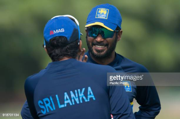 Sri Lankan captain Dinesh Chandimal applies sun cream on his face watching by team mate Upul Tharanga's sun glasses during a training session ahead...
