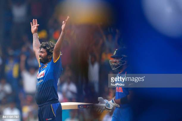 Sri Lankan captain Lasith Malinga celebrates after taking his 300 th wicket in One Day international cricket during the 4th One Day International...