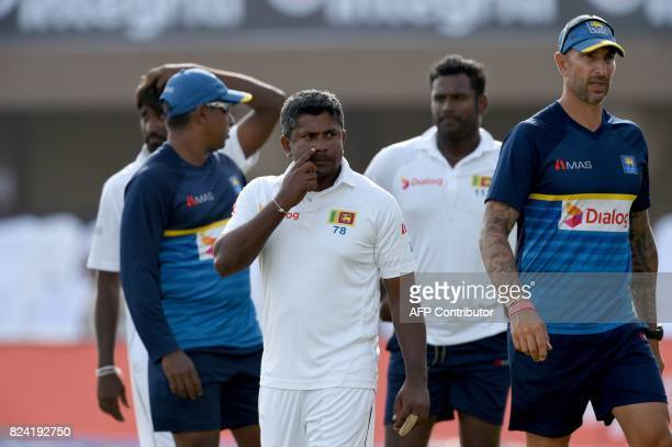 Sri Lankan captain Rangana Herath and coach Nic Pothas react after the fourth day of the first Test match between Sri Lanka and India at Galle...