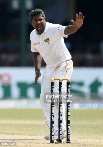 Sri Lankan captain Rangana Herath unsuccessfully appeals for a wicket during the fifth and final day of the second and final Test cricket match...