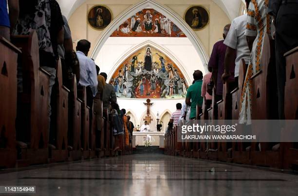 TOPSHOT Sri Lankan Catholic devotees pray during a mass at the St Theresa's church as the Catholic churches hold services again after the Easter...