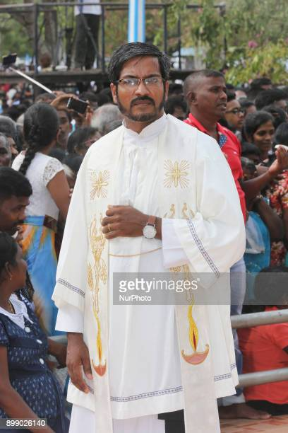 Sri Lankan Catholic priest at the Shrine of Our Lady of Madhu during the Feast of Our Lady of Madhu in Mannar Sri Lanka With a history of over 400...