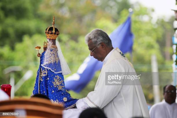 Sri Lankan Catholic priest recites prayers at the Shrine of Our Lady of Madhu during the Feast of Our Lady of Madhu in Mannar Sri Lanka With a...