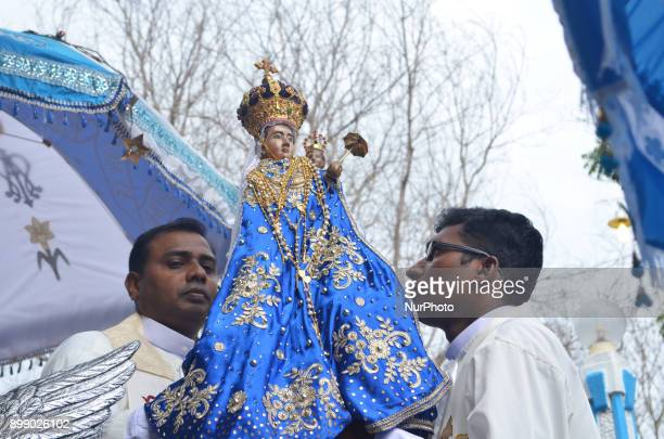 Sri Lankan Catholic priests carry the statue of Our Lady of Madhu and place it on the float to carry it to the church during the Feast of Our Lady of...