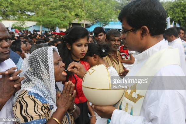 Sri Lankan Catholic priests perform communion at the Shrine of Our Lady of Madhu during the Feast of Our Lady of Madhu in Mannar Sri Lanka With a...