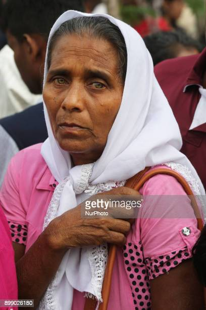 Sri Lankan Catholic woman listens to prayers being recited at the Shrine of Our Lady of Madhu during the Feast of Our Lady of Madhu in Mannar Sri...