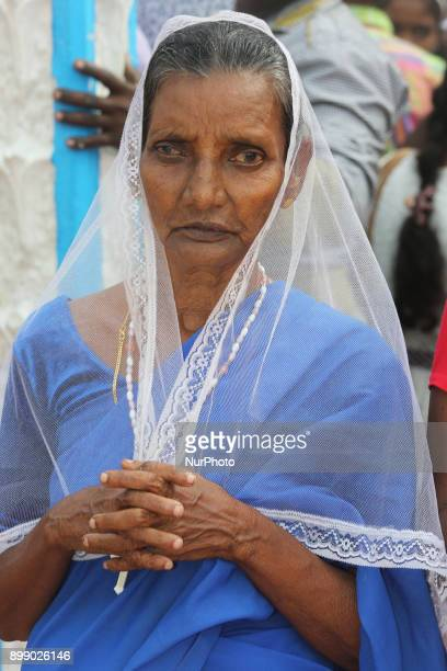 Sri Lankan Catholic woman praying at the Shrine of Our Lady of Madhu during the Feast of Our Lady of Madhu in Mannar Sri Lanka With a history of over...