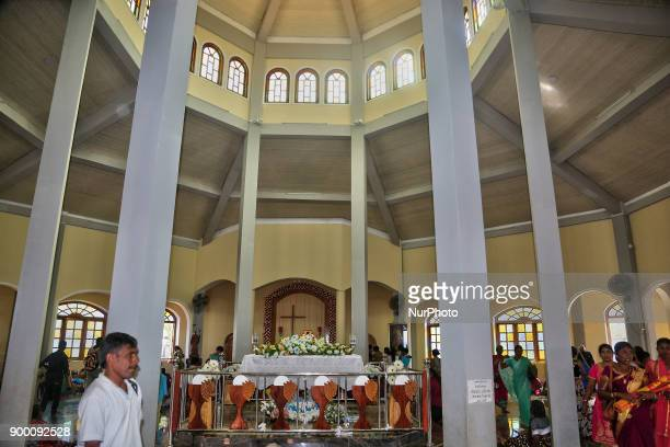 Sri Lankan Catholics pray in the Blessed Sacrament Chapel on the grounds of the Madhu Church in Mannar Sri Lanka