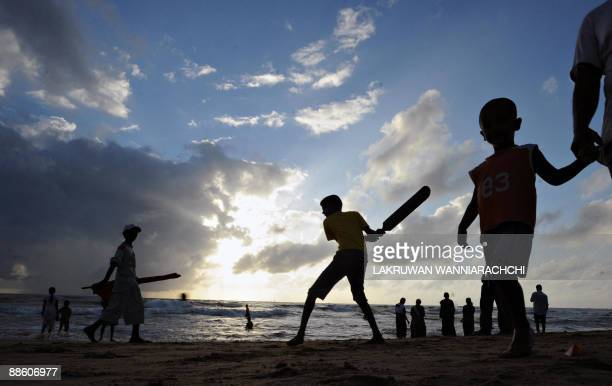 Sri Lankan children play cricket on a beach in Colombo on June 21 2009 The ICC Twenty20 cricket World Cup finals match between Sri Lanka and Pakistan...