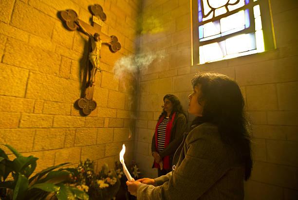 https://media.gettyimages.com/photos/sri-lankan-christian-pilgrims-pray-in-the-nazareths-basilica-of-the-picture-id158710489?k=6&m=158710489&s=612x612&w=0&h=Tok32WFgM2M7ltwjg8vglSlJMedx5GTYz3EgMefrRXc=