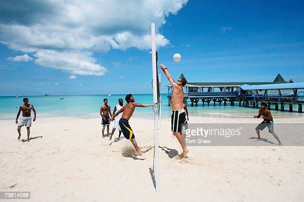 Sri Lankan coach Tom Moody tries to block a smash by Kumar Sangakkara of Sri Lanka as members of the team play beach volleyball at the Halcyon Cove...