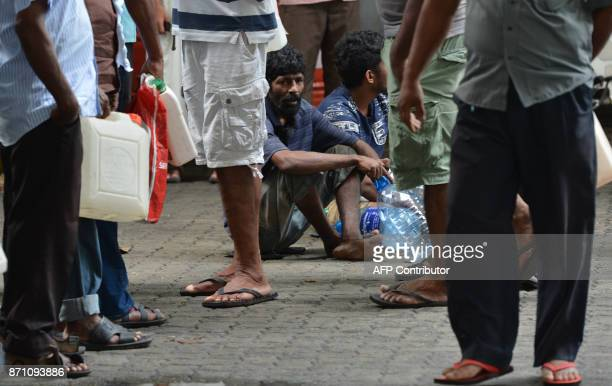 Sri Lankan commuters wait in a queue at a fuel station in Colombo on November 7 2017 A Sri Lankan minister was forced on November 6 to apologise for...