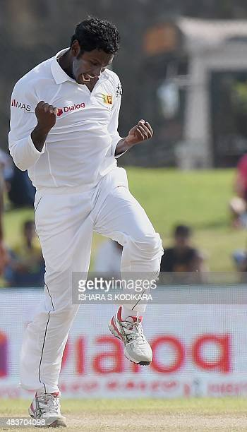 Sri Lankan cricket captain Angelo Mathews celebrates after dismissing Indian cricketer Rohit Sharma during the first day of the opening Test match...