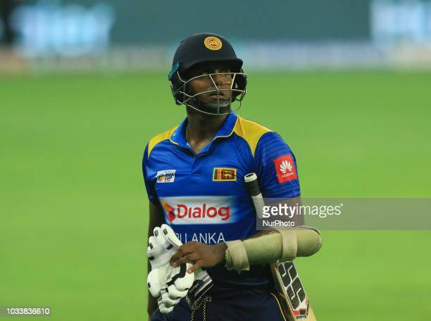 Sri Lankan cricket captain Angelo Mathews walks back following his dismissal during the first cricket match of Asia Cup 2018 between Sri Lanka and...