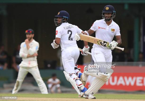 Sri Lankan cricket captain Dimuth Karunaratne and Kusal Mendis run between the wickets during the first day's play of the second test cricket match...