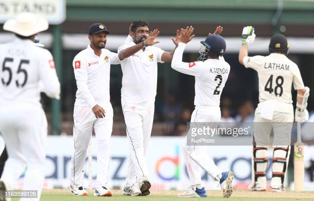 Sri Lankan cricket captain Dimuth Karunaratne Dilruwan Perera Kusal Mendis celebrate after an unsuccessful appeal for a wicket during the third day's...