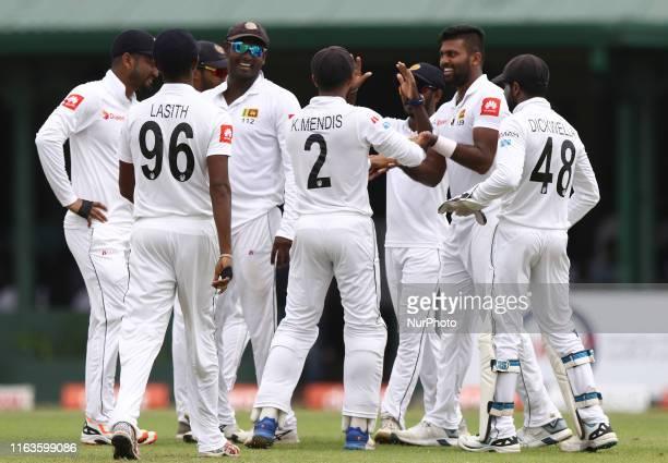 Sri Lankan cricket captain Dimuth Karunaratne Lasith Embuldeniya Angelo Mathews Kusal Mendis Niroshan Dickwella celebrates with Lahiru Kumara after...