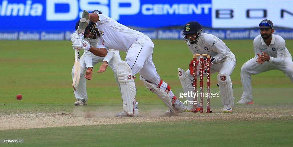 Sri Lankan cricket captain Dinesh Chandimal(L) plays a shot as Indian wicket keeper Wriddhiman Saha (2L) looks on during the 2nd Day's play in the 2nd Test match between Sri Lanka and India at the SSC international cricket stadium at the capital city of Colombo, Sri Lanka on Friday 04 August 2017.