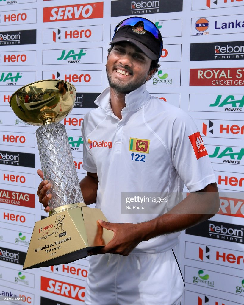 Sri Lankan cricket captain Dinesh Chandimal poses with the winners trophy during the post match presentation during the final day's play in the only test match between Sri Lanka and Zimbabwe at R Premadasa International Cricket stadium, Colombo, Sri Lanka on Tuesday 18 July 2017