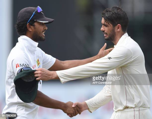 Sri Lankan cricket captain Dinesh Chandimal shakes hands with Zimbabwe cricket captain Graeme Cremer after Sri Lanka beat Zimbabwe by four wickets on...
