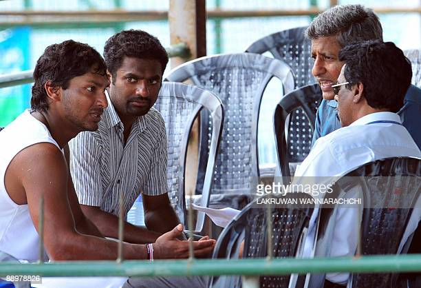Sri Lankan cricket captain Kumar Sangakkara and teammate Muttiah Muralitharan gesture while speaking to members of The Sri Lankan Cricket Interim...