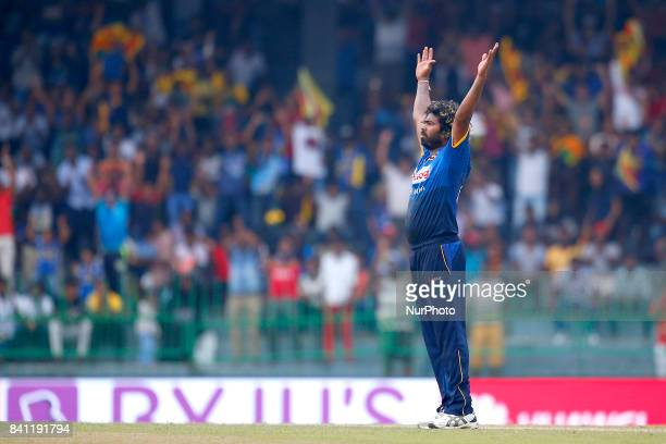 Sri Lankan cricket captain Lasith Malinga celebrates after completing 300 wickets in his One Day International career during the 4th One Day...