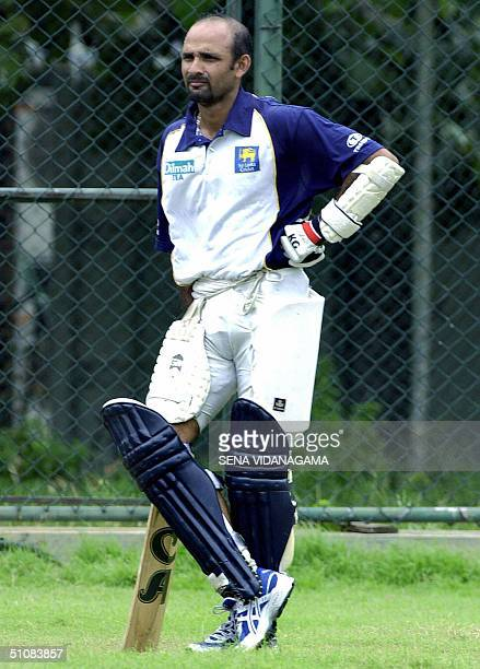 Sri Lankan cricket captain Marvan Atapattu leans on his bat during a net practice session in Colombo 20 July 2004 Atapattu and his teammates will...