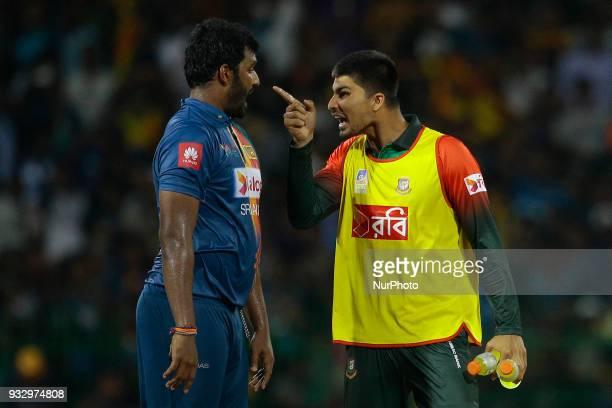 Sri Lankan cricket captain Thisara Perera and Bangladesh cricketer Nurul Hasan are seen in a conversation during 6th T20 cricket match of NIDAHAS...