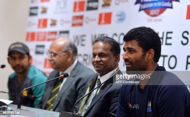 Sri Lankan cricket captain Thisara Perera speaks next to Sri Lanka Cricket President Thilanga Sumathipala Chairman of Pakistan Cricket Board Najam...