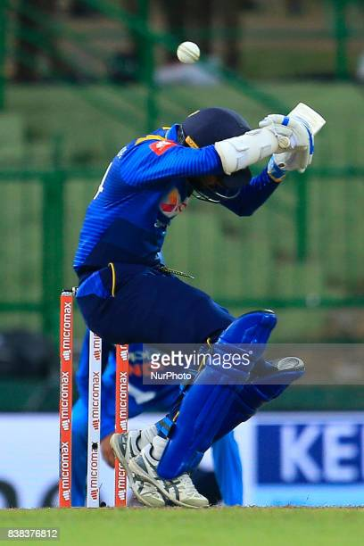 Sri Lankan cricket captain Upul Tharanga avoids a bouncer ball during the 2nd One Day International cricket match between Sri Lanka and India at the...