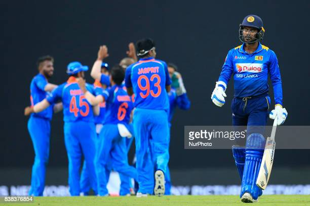 Sri Lankan cricket captain Upul Tharanga walks back following his dismissal during the 2nd One Day International cricket match between Sri Lanka and...