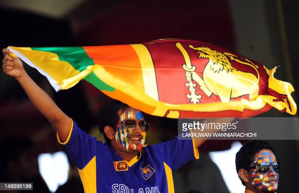 A Sri Lankan cricket fan waves the national flag during the third one day international match between Sri Lanka and India at the RPremadasa Cricket...