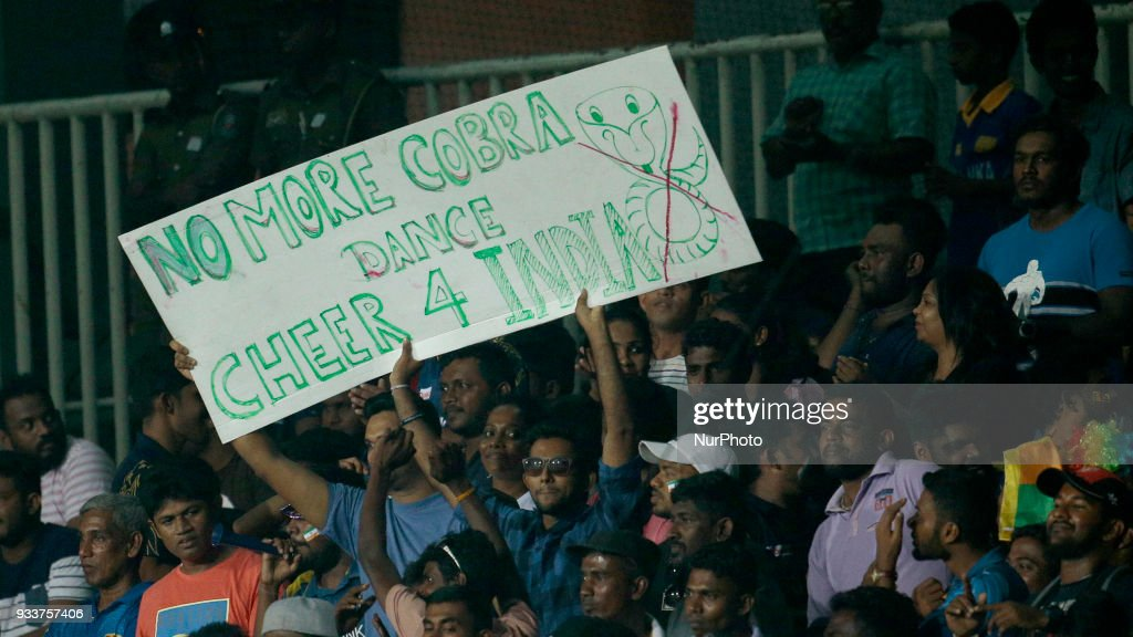 Sri Lankan cricket fans display a banner 'No more Cobra Dance, cheer for India' during the final Twenty-20 cricket match of NIDAHAS Trophy between Bangladesh and India at R Premadasa cricket ground, Colombo, Sri Lanka on Sunday 18 March 2018.