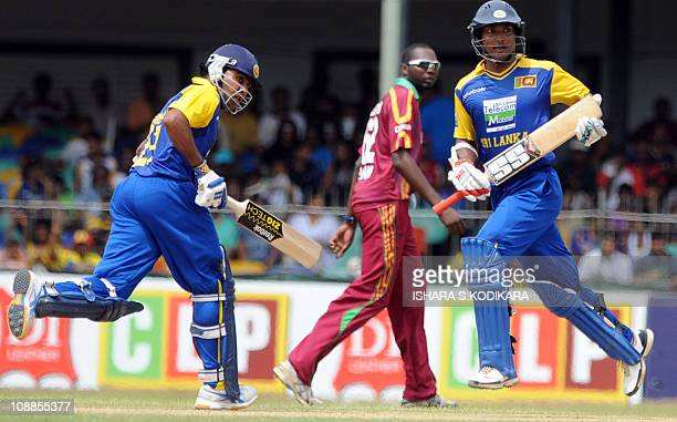 Sri Lankan cricket team captain Kumar Sangakkara and cricketer Mahela Jayawardene run between the wickets during the third One Day International...