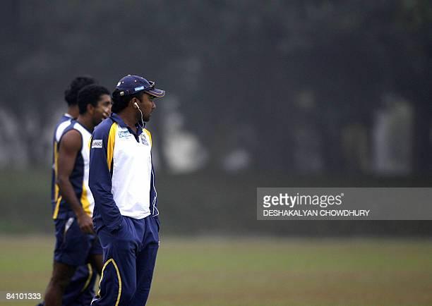 Sri Lankan cricket team captain Mahela Jayawardene and teammates looks around a foggy field at Bangladesh Krira Shikkha Protisthan Ground in Savar...