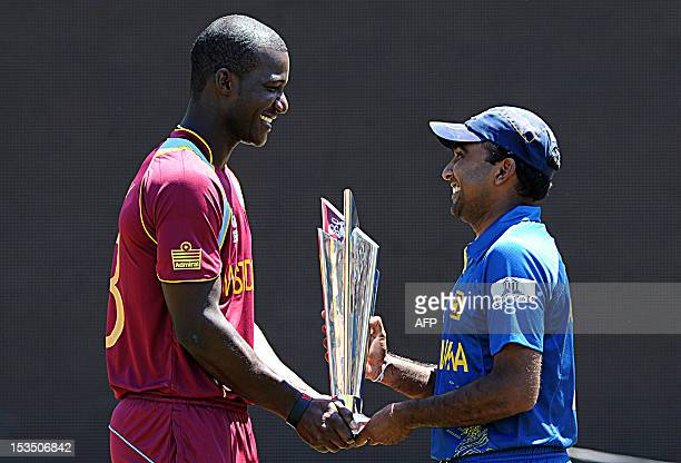 Sri Lankan cricket team captain Mahela Jayawardene and West Indies cricket captain Darren Sammy pose for photographers with the ICC Twenty20 Cricket...
