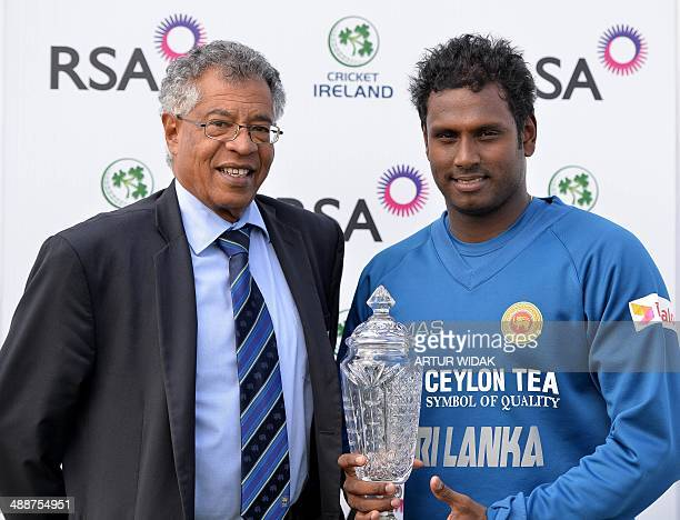 Sri Lankan Cricket Team Manager Michael de Zoysa and team captain Angelo Mathews pose with the Trophy at the Clontarf Cricket Club Ground in Dublin...