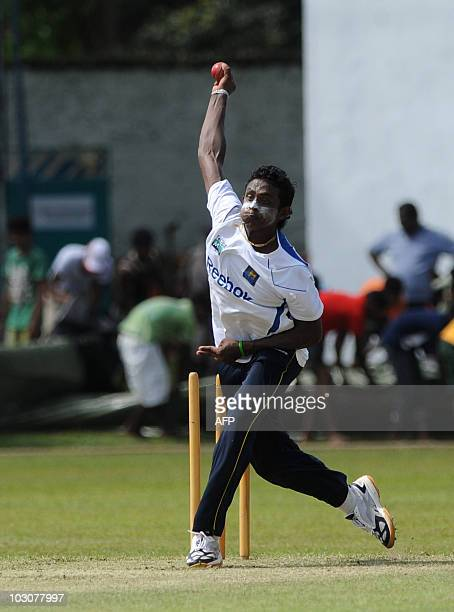 Sri Lankan cricketer Ajantha Mendis delivers a ball during a practice session at The Sinhalese Sports Club Ground in Colombo on July 25 ahead of the...