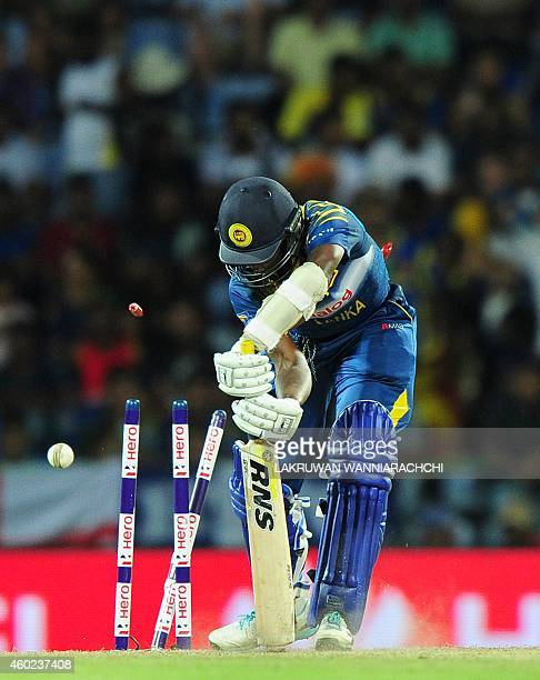 Sri Lankan cricketer Ajantha Mendis is bowled by England cricketer Chris Woakes during the fifth One Day International match between Sri Lanka and...