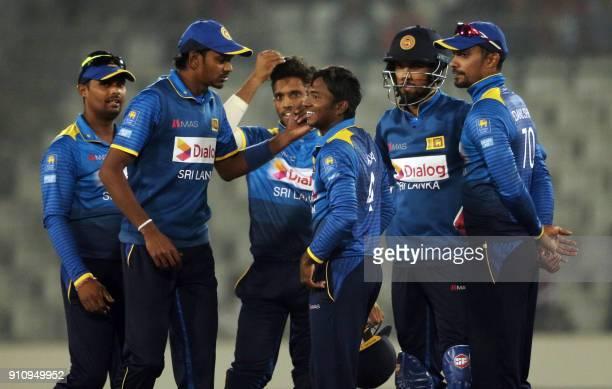 Sri Lankan cricketer Akila Dananjaya celebrates after dismissal of Bangladesh cricketer Mehedi Hasan Miraz during the Final One Day International...