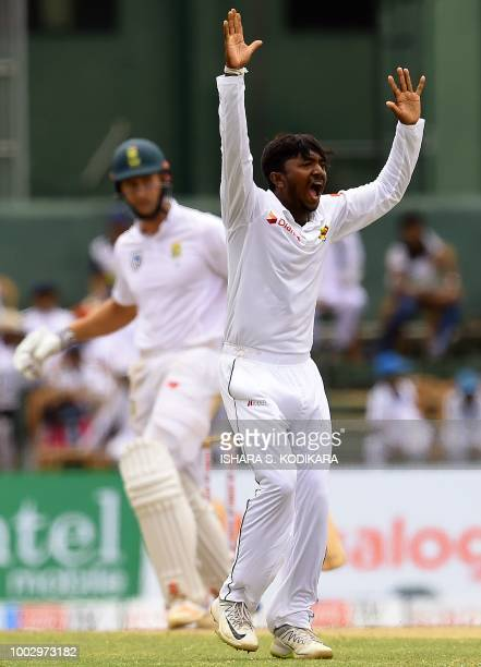 Sri Lankan cricketer Akila Dananjaya celebrates after he dismissed South Africa's Theunis de Bruyn during the second day of the second Test match...