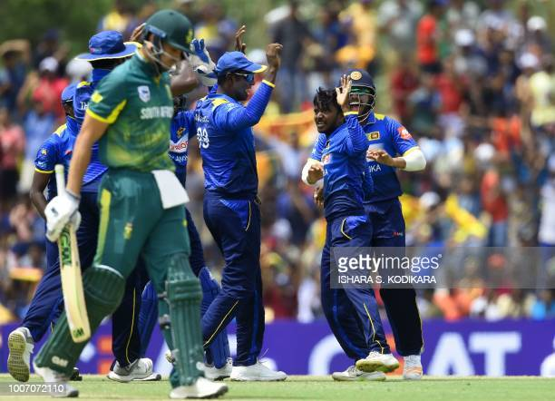 Sri Lankan cricketer Akila Dananjaya celebrates after he dismissed South Africa's Aiden Markram during the first One Day International cricket match...