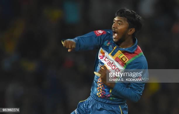 Sri Lankan cricketer Akila Dananjaya celebrates the dismissal of Bangladesh cricketer Liton Das during the sixth Twenty20 international cricket match...