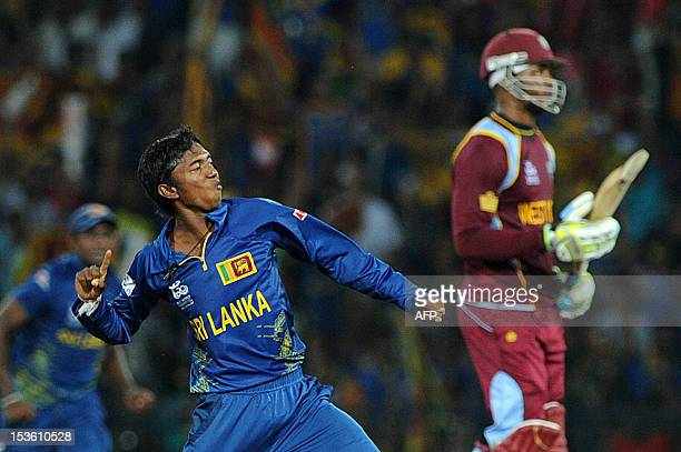 Sri Lankan cricketer Akila Dananjaya celebrates the dismissal of West Indies batsman Marlon Samuels during the ICC Twenty20 Cricket World Cup's final...
