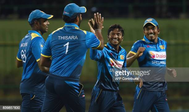 Sri Lankan cricketer Akila Dananjaya celebrates with his teammates after he dismissed Indian batsman Lokesh Rahul during the third one day...