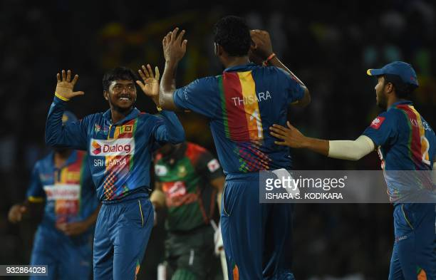 Sri Lankan cricketer Akila Dananjaya celebrates with teammates after he dismissing Bangladesh cricketer Liton Das during the sixth Twenty20...