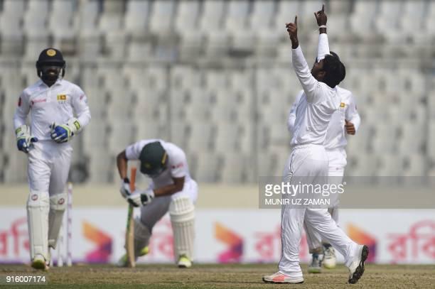 Sri Lankan cricketer Akila Dananjaya reacts after the dismissal of the Bangladesh cricket captain Mahmudullah Riyad during the second day of the...