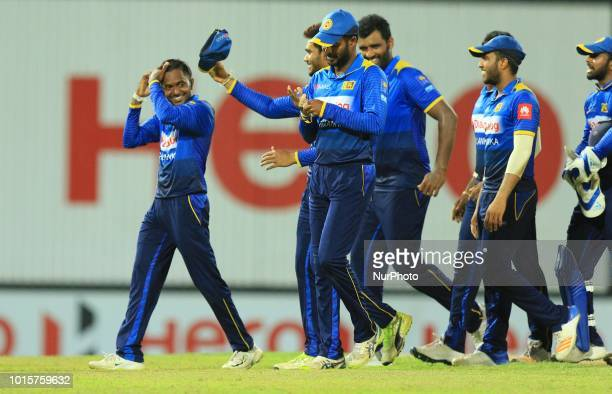 Sri Lankan cricketer Akila Dananjaya walks away with his team members after defeating South African cricket team during the 5th and final One Day...